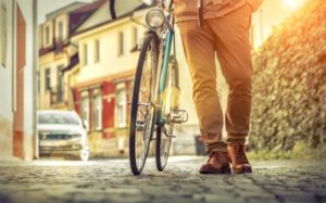 Man walking with a bicycle.
